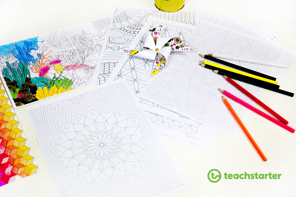 a selection of printable mindfulness colouring sheets with a few pencils laying around