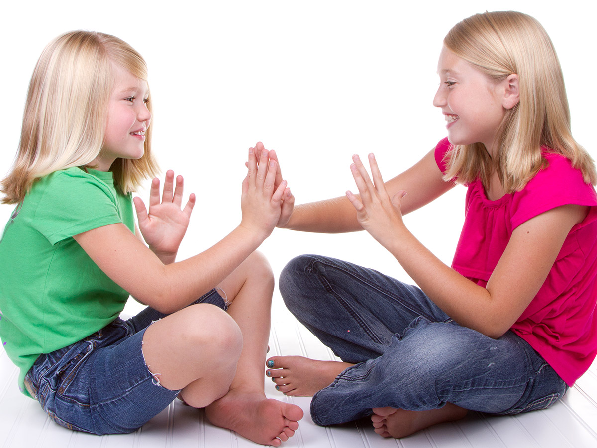 Girls playing clapping games
