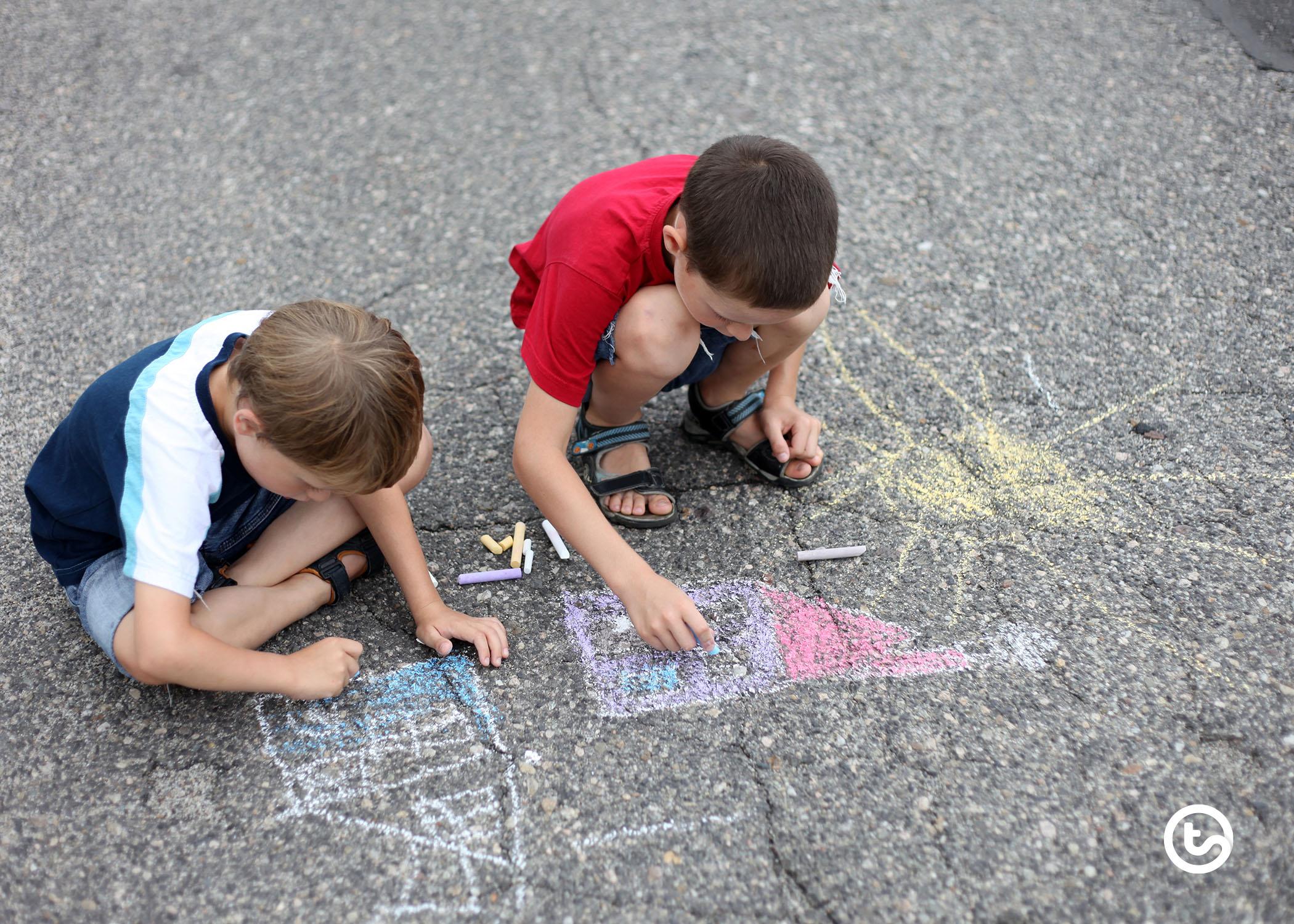 Using sidewalk chalk for learning.