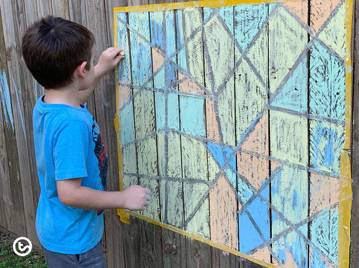 Use sidewalk chalk to create artwork on fences