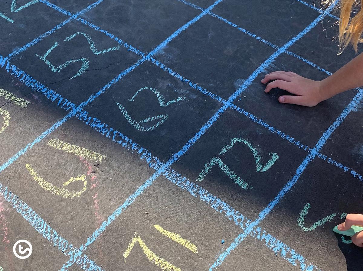 Create a giant hundreds chart using sidewalk chalk.