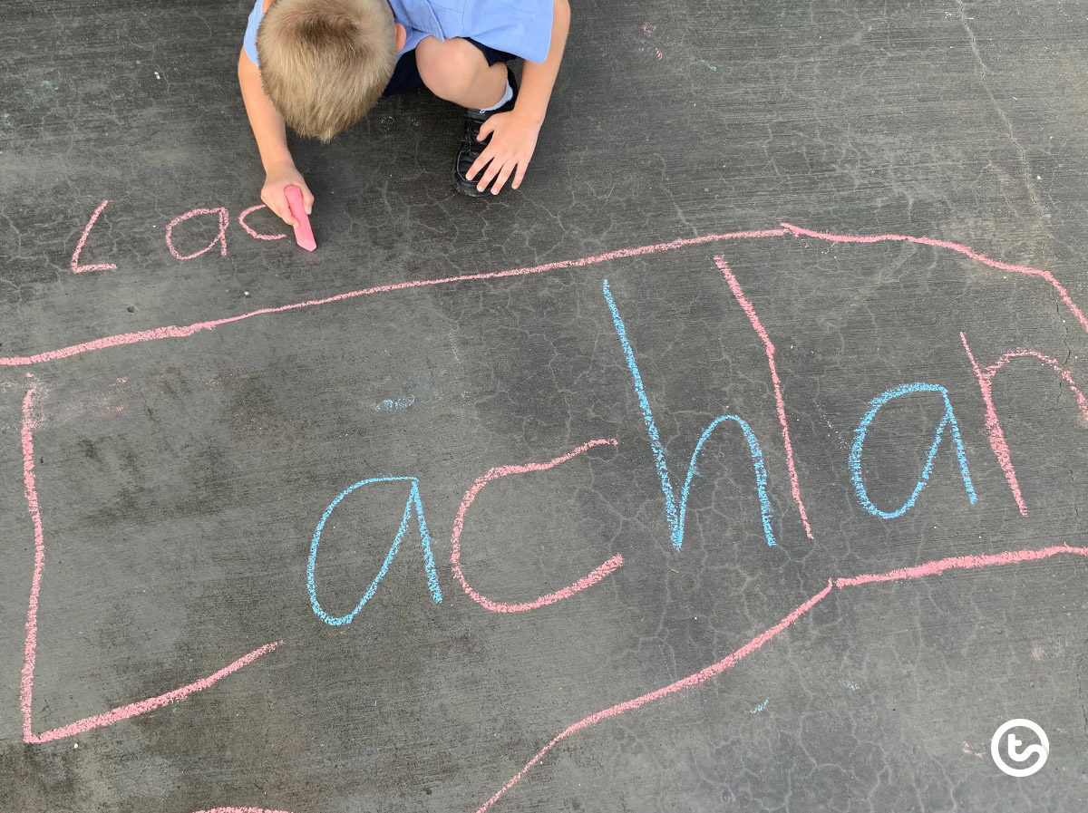 Practice writing words using sidewalk chalk on cement.