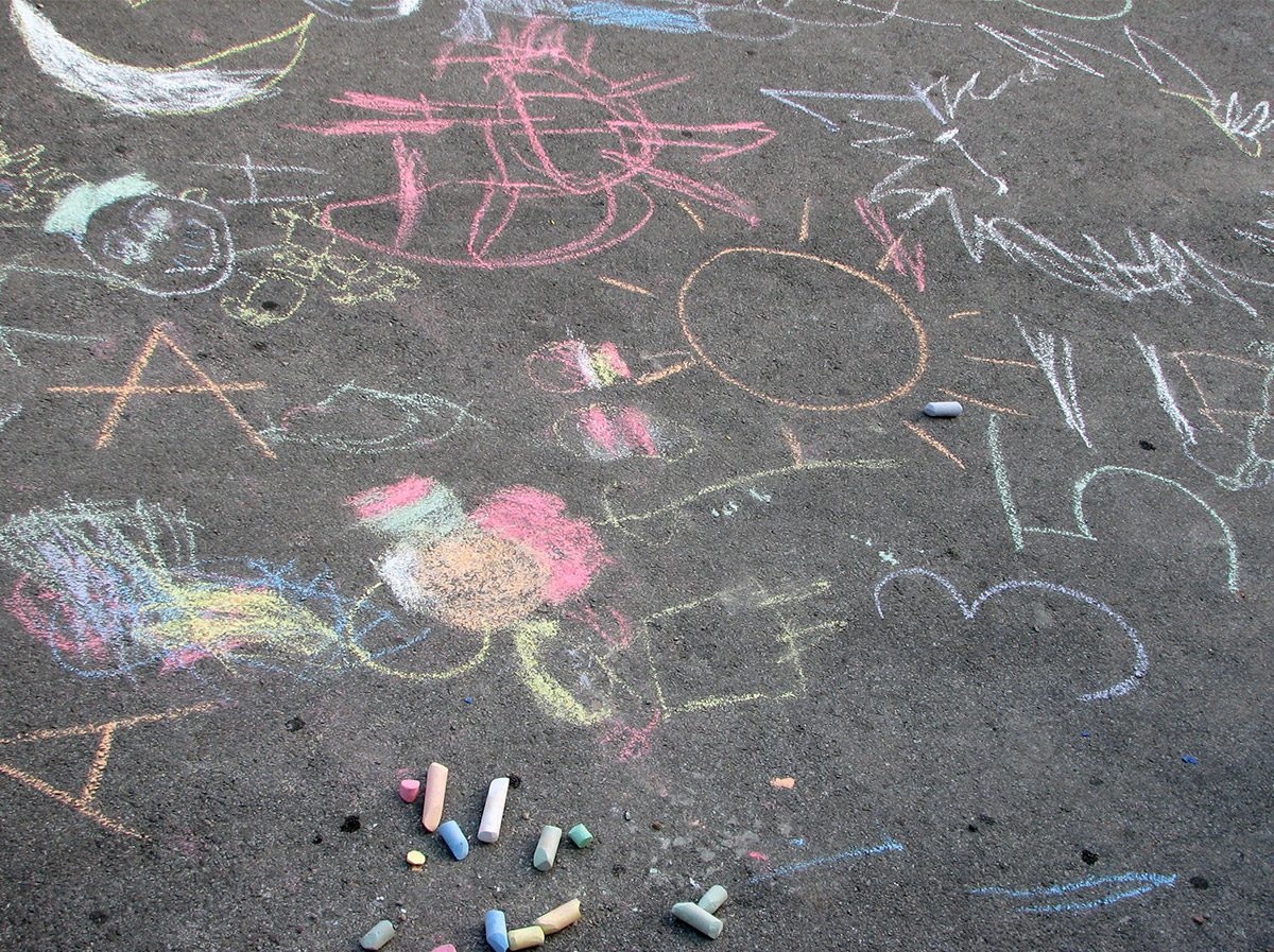 Chalk drawings on cement by child.